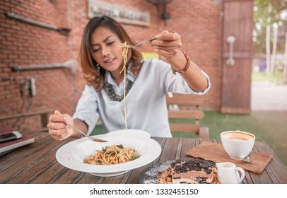 Asian women eating delicious,Focus on fork.