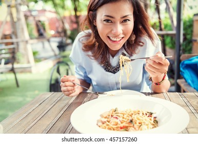 Asian women eating delicious,Focus on face