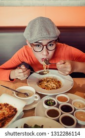 Asian women  enjoy eating delicious food.Focus on face