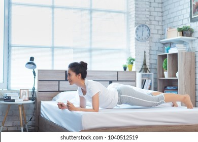 Asian women exercising in bed in the morning, she feels refreshed.She acted plank