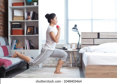 Asian women exercising in bed in the morning, she feels refreshed.She acts as squat.