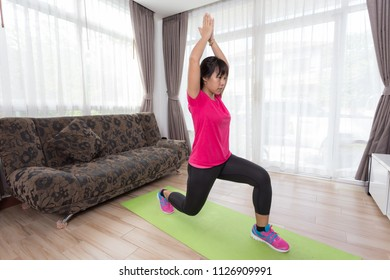 Asian women are exercising at home, female doing exercise indoor