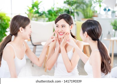 asian women friend are talking about thier healthy skin and teeth