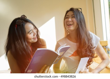 Asian women friendship talking laughing and smiling in coffee cafe - young female student friend lifestyle portrait