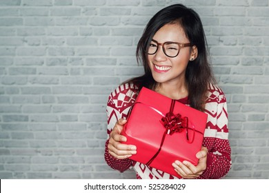 Asian women are happy to receive a gift box in the festival, Focus on face.