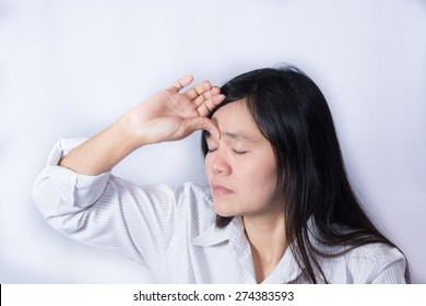 Asian women  have a sore eyes.