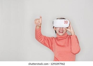 Asian women laugh and enjoy using VR equipment.Focus on VR