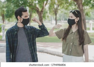 Asian women man a wearing face mask hello shake hand new normal social distancing,No touching