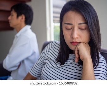 Asian women mourn and become irritated by their husband's behavior. After an argument and causing pain in the heart. Angry and not understanding each other, resulting to divorce