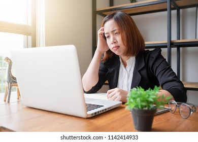 Asian women office workers headache income of the company