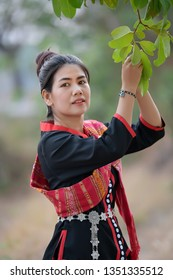 Asian women in Phutai costume and green background