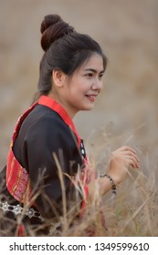 Asian women in Phutai costume at meadow