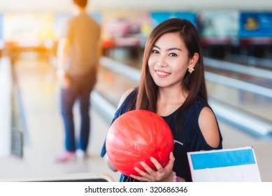 Asian women playing bowling