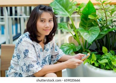 asian women playing smartphone