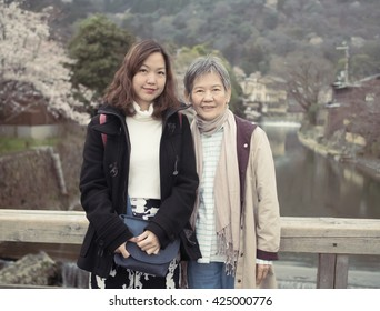 Asian women portrait - Senior mother and adult daughter looking and smiling to the camera at Nishikyo-ku, Kyoto, Japan