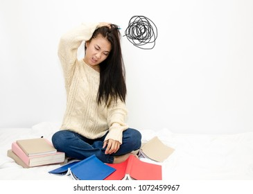 Asian women read books.Women wear white shirt do not understand the lesson.Read books do not understand.There is no doubt in reading.Bad reading