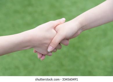 Asian women shaking hands