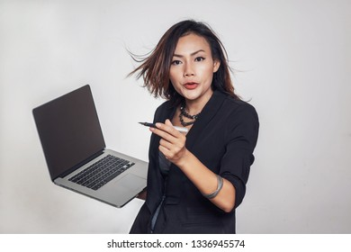 Asian women are standing talking with Mobile, laptop computer