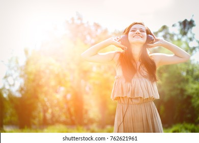 Asian women in summer with headphones listening to music and relaxing