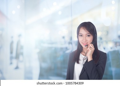 Asian Women Telemarketing call center or female customer support phone operator 20-30 years old wearing microphone headset at Customer Service Agent.copy space area for text message.Positive emotion