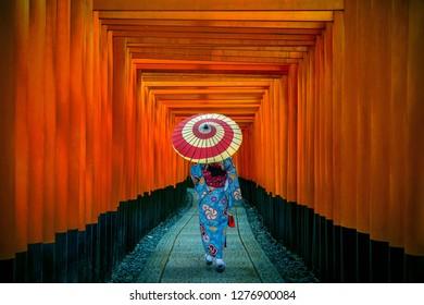 Asian women in traditional japanese kimonos at Fushimi Inari Shrine in Kyoto, Japan.