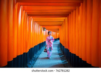 Asian women in traditional japanese kimonos at Fushimi Inari Shrine in Kyoto, Japan.
