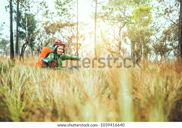 Asian women travel  Nature. Travel relax. Touch natural mountain meadow. walk in the forest. Thailand