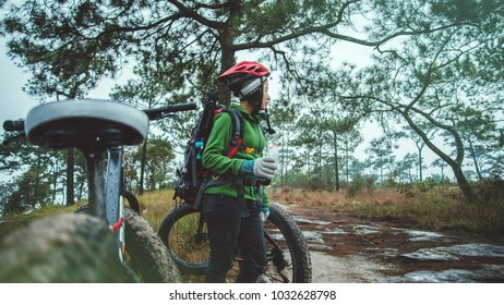 Asian women Travel photograph Nature. Travel relax ride a bike Wilderness in the wild. Thailand