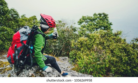 Asian women Travel photograph Nature. travel relax in the holiday walk in the forest. on a rocky cliff. Thailand
