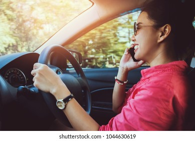 Asian women travel relax in the holiday. drive a carHappy travel. talking on the phone. Thailand