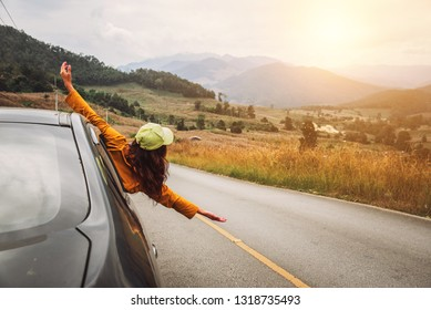 Asian women travel relax in the holiday. driving a car traveling happily.