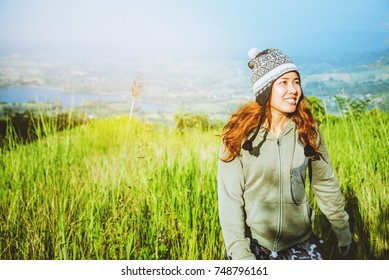 Asian women travel relax in the holiday. green pasture on the Mountain. Thailand