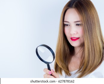 Asian Women use Magnifying glass, on white background.