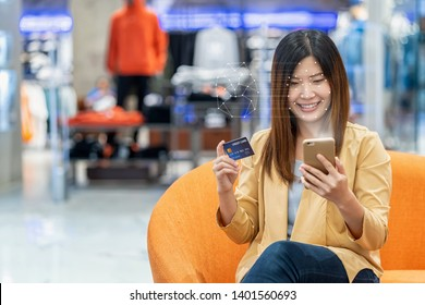 """""""Asian women using the technology tablet for access control by face recognition in private identification step when online shopping with the credit card, credit card mockup, online payment concept,"""""""