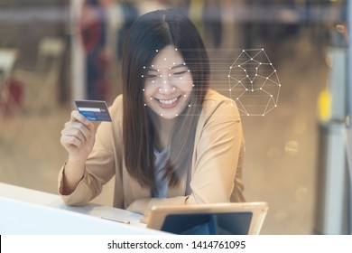 Asian women using the technology tablet for access control by face recognition in private identification step when online shopping with the credit card, credit card mockup, online payment concept,