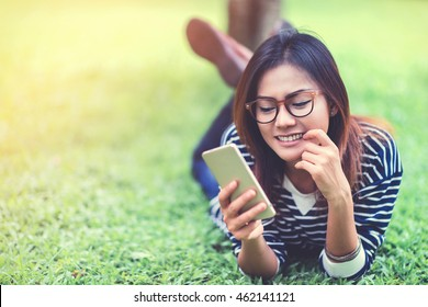 Asian women are using their mobile phone happy mood,focus on face