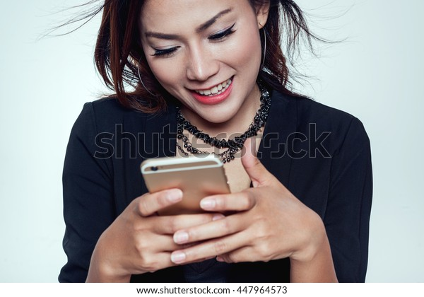 Asian women are using their mobile phones. Happy mood