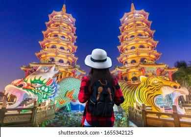 Asian women visit Dragon and the tiger pagoda at the lotus pond  at night