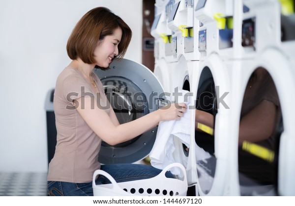Asian women washing clothes at the laundry shop