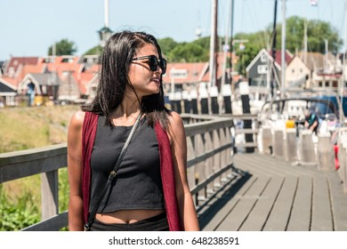 Asian women at waterfront looking out over the ocean, Asian young casual women at the Harbor