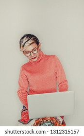Asian women wear glasses when she uses the computer.focus on face