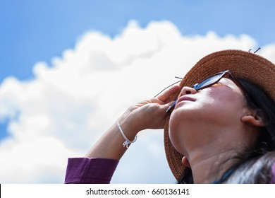asian women wear sunglasses with sunlight rays