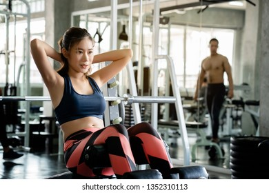 Asian women wearing blue tightening exercises are Play abdominal muscles. With a relaxed feel in the gym, which is a set to help keep the body healthy. concept health care and Fitness