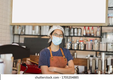 Asian women wearing protective mask standing in cafe during covid-19 preventing.