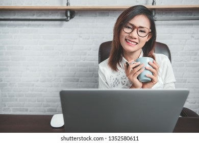 Asian women who are enjoying her work at home.Focus on face
