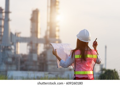 Asian women work  experience and professional occupational engineer electrician with safety control at power plant energy industry and construction , Thailand.  Engineer Concept