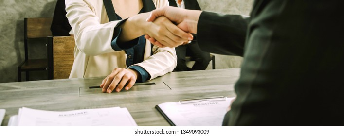 Asian women,handshake Human Resources Department company to congratulate female candidates selected to work,concept selection and employment,Of new graduates,banner horizontal panoramic background