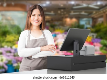 asian worker with cashier desk in store