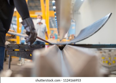 Asian worker in factory at metal workshop - bender