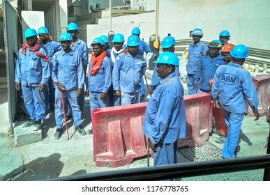 Asian workers in Dubai. A group of Asian workers at the construction site. Dubai. August 2018.
